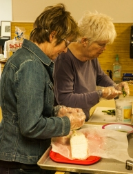 Kate Painter and Kathy Sheffler prepare hors d'oeuvres.